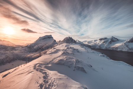Landscape of colorful snowy hill with footprint at sunrise morning