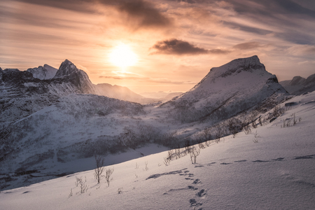 Landscape of sunrise on snowy mountain at peak of Segla, Norway