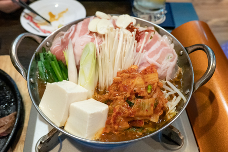 Japanese shabu with vegetable, tofu, sliced pork and beef in electric pot