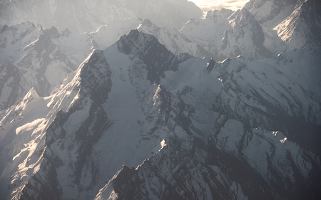 Peak of rocky mountain with sunlight shine
