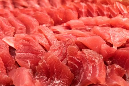 Close-up pile of fresh tuna fish background