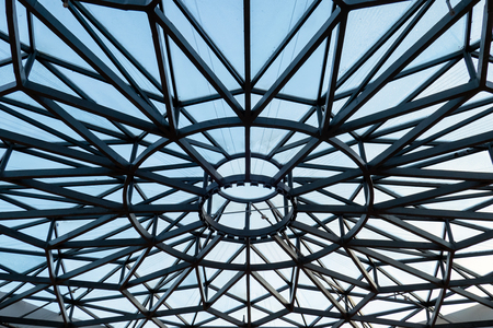 Metal roof shape of spider web covered with blue sky