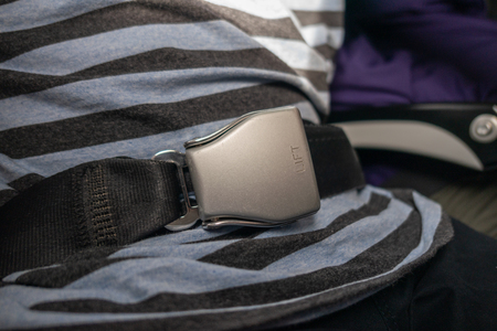 Passenger fastening seat belt for safety on the airplane