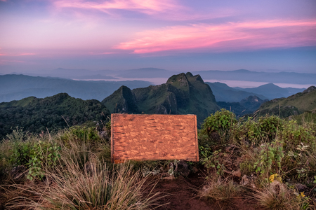 Wooden signboard text of Doi Luang Chiang Dao national park at sunset  Stock Photo