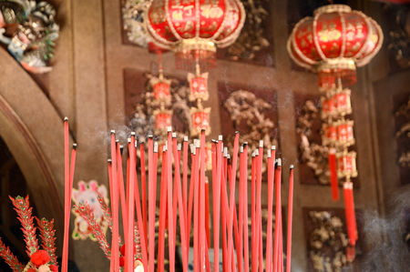Burning big red incense in chinese temple Imagens