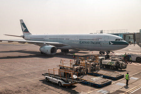 Surabaya, Indonesia - Sep 13 2018 : Airplane Cathay Pacific with truck cargo on terminal in the airport