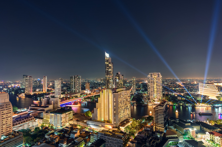 Golden light buildings in downtown with Chao Phraya river in New Year festive at Bangkok city Editorial