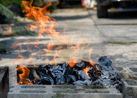 Burning paper for faith to the ancestors in chinese new year holidays