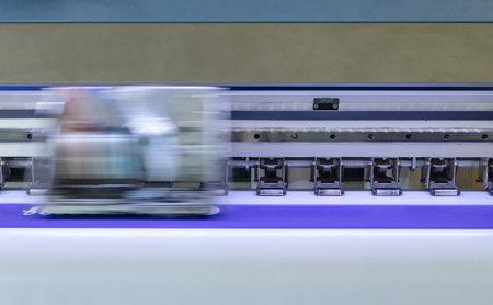 Large inkjet printer with head printing on white vinyl banner