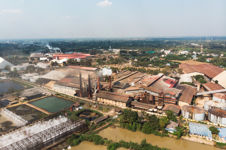 Industry factory manufacturing with emission smoke from chimneys into sky