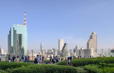 Bangkok, Thailand - Jan 26 2019 : People relaxing in garden on patio and views of skyscraper at bangkok Editorial
