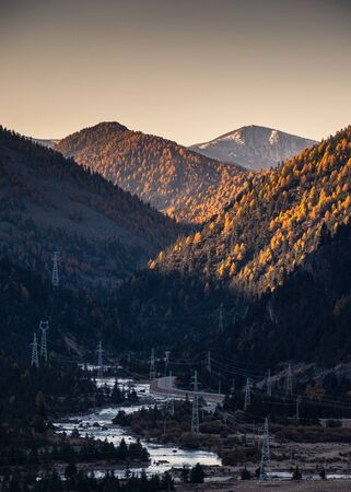 Scenery sunrise on mountain with electric poles and river in autumn at national park