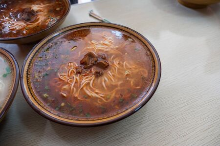 Chinese noodle with beef in spicy soup on bowl Reklamní fotografie