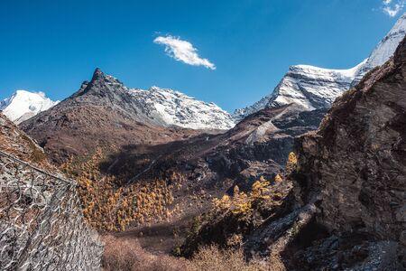 Landscape of peak limestone mountain range with blue sky at Yading nature reserve 스톡 콘텐츠