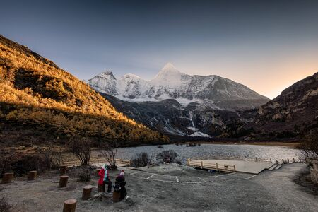 Holy mountain yangmaiyong with lake in autumn valley at Yading nature reserve