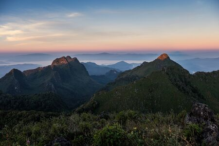 Landscape of mountain range in wildlife sanctuary at sunrise. Doi Luang Chiang Dao, Chiang Mai