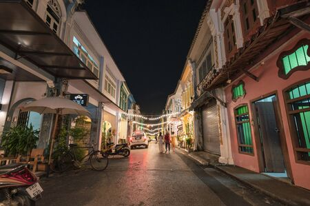 Phuket, Thailand - Dec 12 2018 : Colorful sino alley townhome with store and lighting decoration at night market, Soi Rommanee