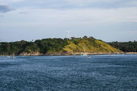 Sailing boat on deep sea with turbine at phuket island