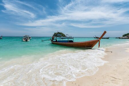 Beautiful crystal tropical sea with wooden boat at lipe island