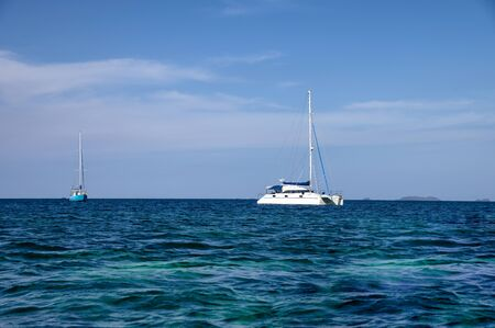 White yachts sailing in tropical sea with blue sky Reklamní fotografie