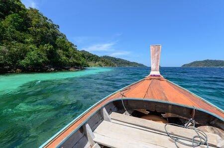 Wooden long-tail boat sailing on tropical sea in summer trip Reklamní fotografie