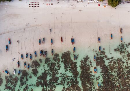 Aerial view of longtail-boat anchored on tropical sea with white beach at Lipe island Reklamní fotografie