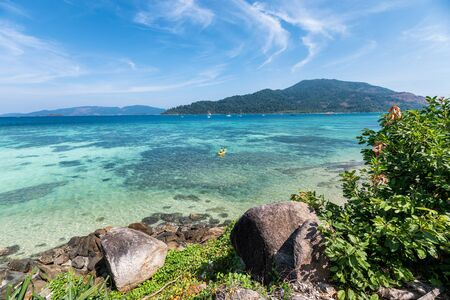 Beautiful tropical sea with coral reef and rocks on coastline at lipe island