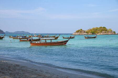 Long-tail wooden boats anchored on tropical sea in andaman at lipe island