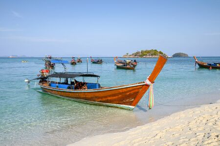 Wooden long-tail boats on tropical sea at Lipe island