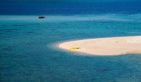 The white beach with yellow canoe in tropical sea at karma beach, lipe island Reklamní fotografie