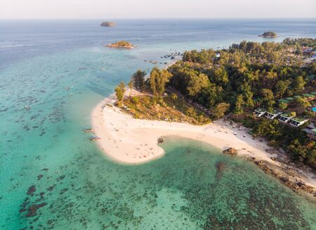 Aerial view of Karma white beach in emerald tropical sea at lipe island