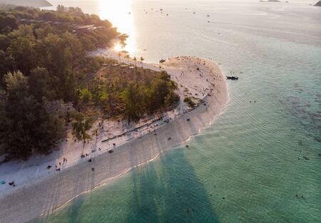 Sunset shining on white sand beach with tropical forest at Lipe island