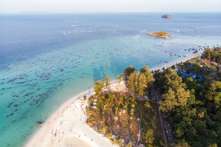 Aerial view Scenery of the beach with sunlight on tree in tropical sea at Lipe island