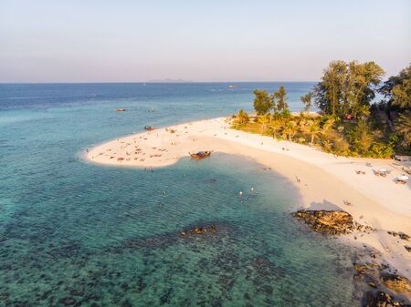 Top view of white beach with coral reef in tropical sea at Lipe island