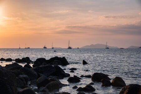 Yachts sightseeing sunset in tropical sea at lipe island