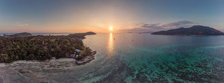 Aerial view of sunset over tropical sea with lipe paradise island in summer