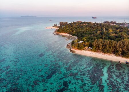 Aerial view of white beach with coral reef in tropical sea at Lipe island