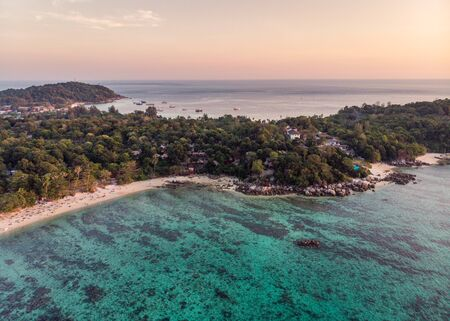 Aerial view of beautiful tropical sea with coral reef at sunset. Lipe island