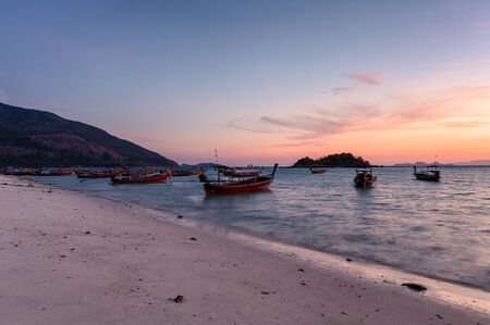 Wooden long-tail boats on tropical sea at sunrise morning beach. Lipe island Reklamní fotografie - 134746483