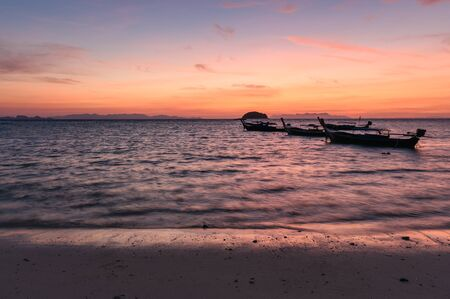 Wooden long-tail boats on tropical sea at sunrise morning beach. Lipe island Reklamní fotografie - 134746484