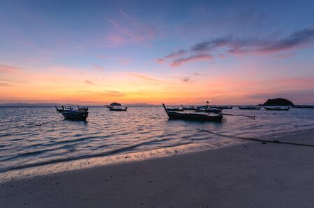 Beautiful tropical sea with wooden boat in sunrise morning at Lipe islands Reklamní fotografie - 134746485