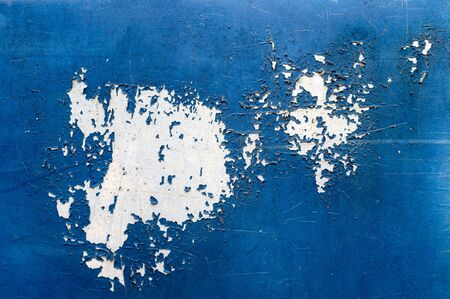 Paint peeling and decay on blue skin of the car background
