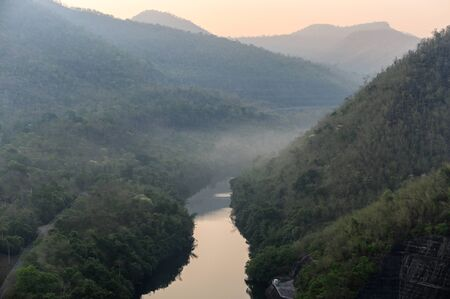 Scenery of river in rainforest valley with foggy in morning Reklamní fotografie