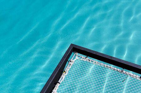 Relaxation mesh seat jut out on swimming pool Reklamní fotografie