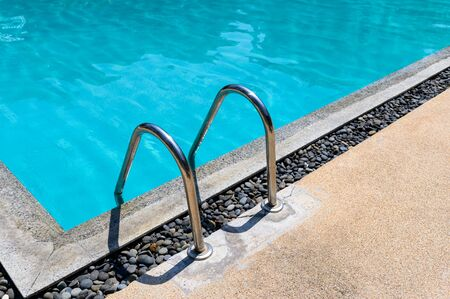 Stainless ladder handrail with stone decorative on swimming pool