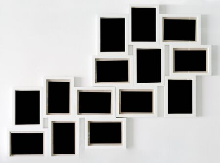 Collection white picture frame and black decorative hanging on white wall