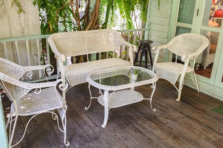 Antique weaving chairs with table on wood patio in living room