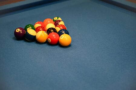 Set of billiard balls arranged in triangle on blue billiard pool table Reklamní fotografie