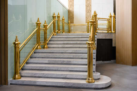 Classical Marble stairs with golden handrail