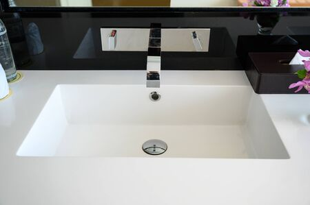 Modern luxury stainless faucet with ceramic sink of automatic sensor and cool with heat control button in bathroom Reklamní fotografie - 134791367